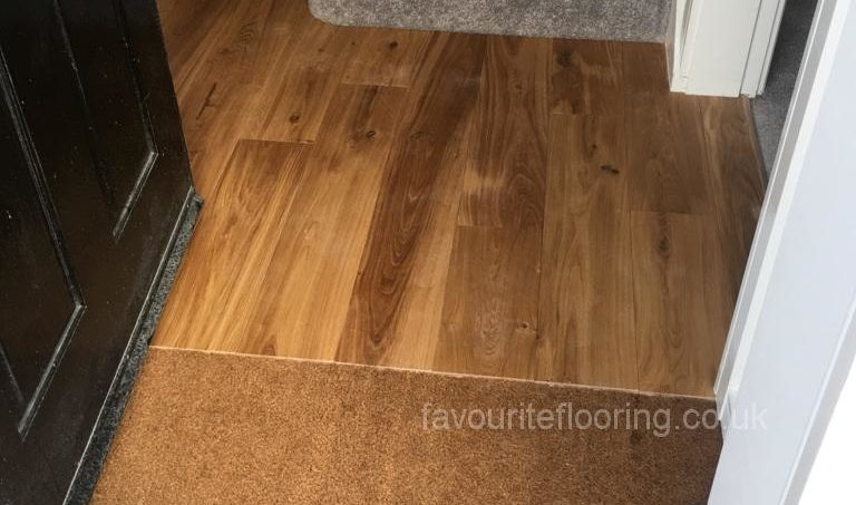 Door mat well and Oak wood flooring