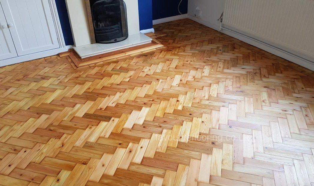 Pine parquet flooring after restoration
