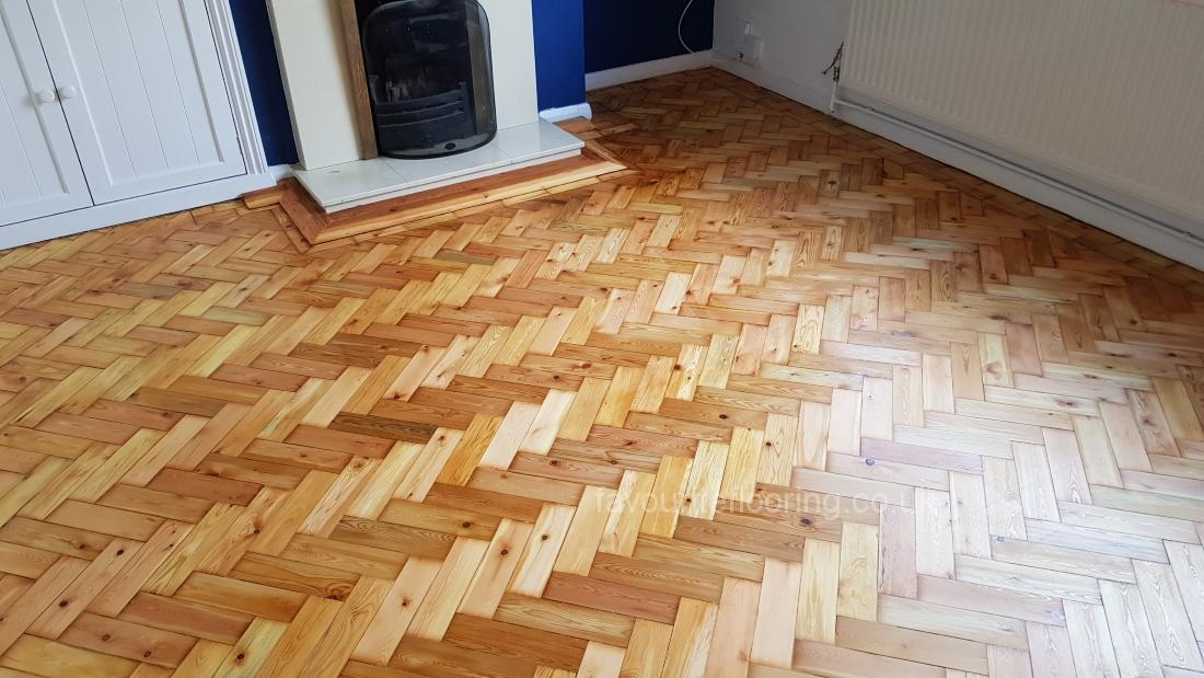 Pine parquet flooring after restoration