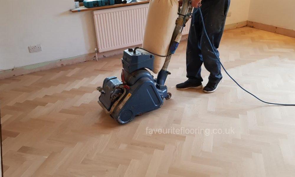 Floor sanding with belt sander in progress