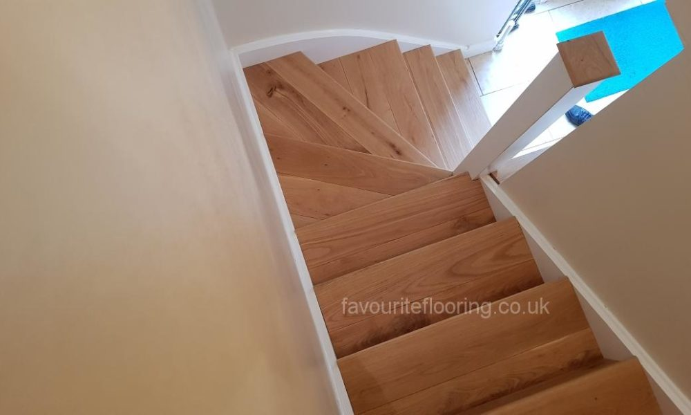 Pine stairs after cladding with oak wood