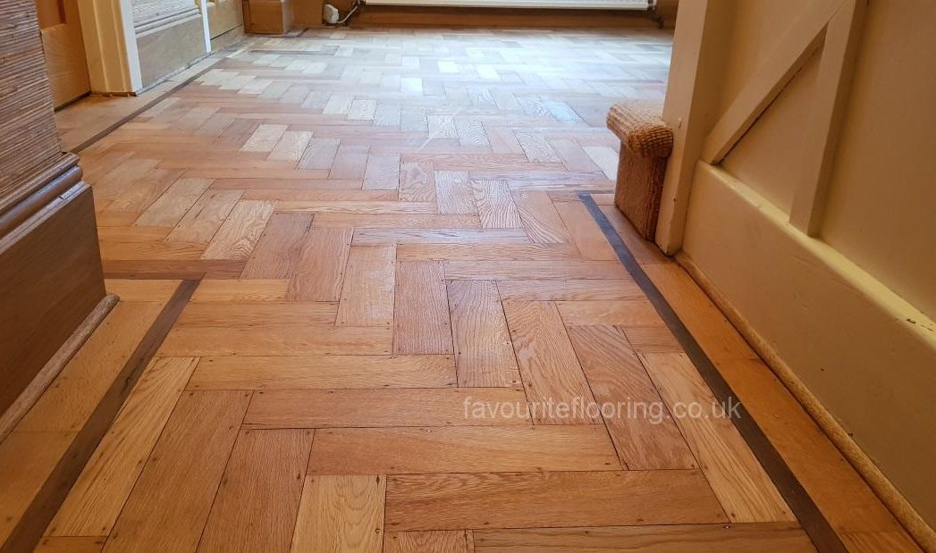 Old parquet flooring with Walnut border