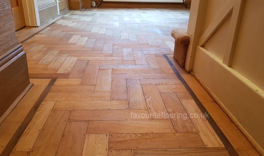 Old parquet flooring with Walnut border