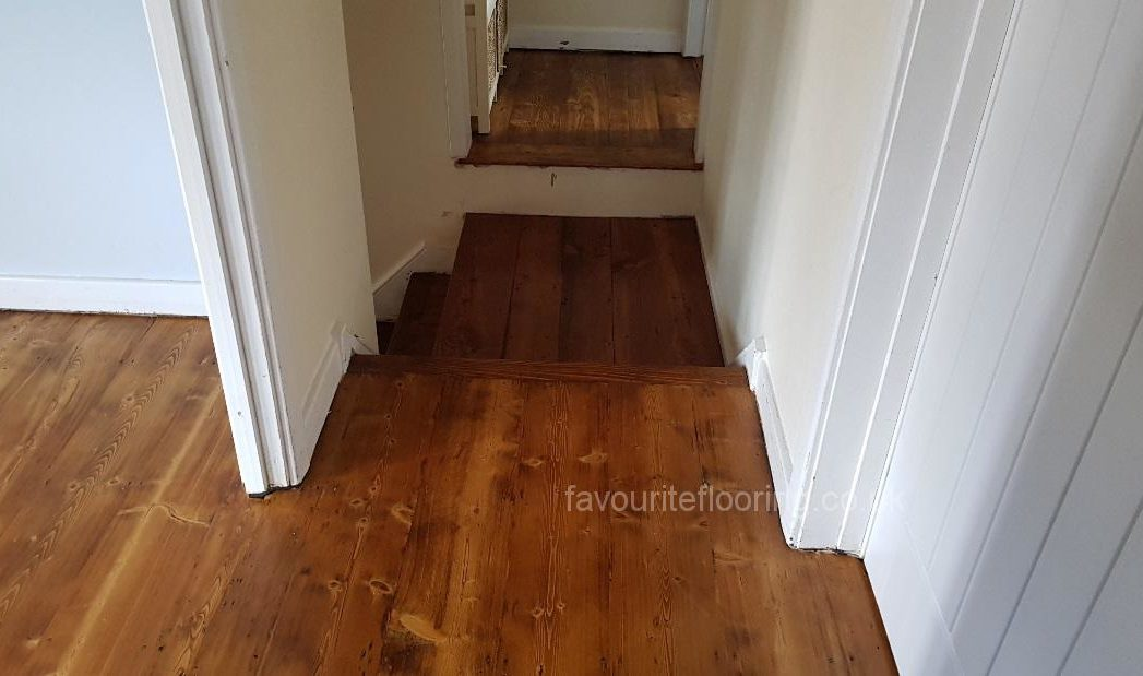 Pine boards and landing with oak dark stain