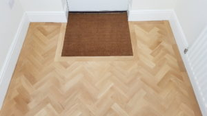 Parquet flooring with door mat finished